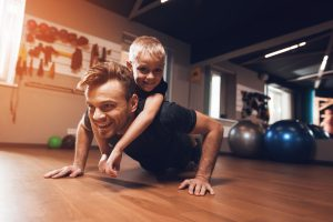 Father and son in the home gym. (Fitness Krazy)