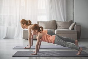 Mother and Daughter doing the plank. (Fitness Krazy)
